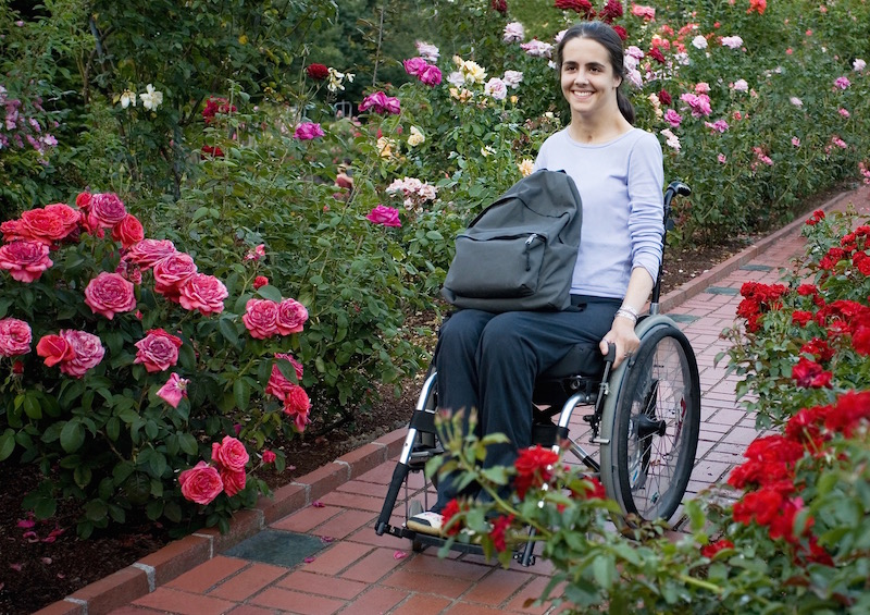 disability live in care lady in wheelchair in garden
